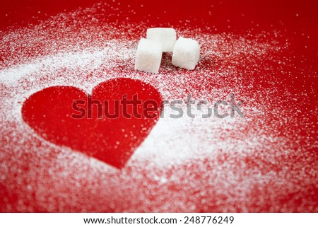 Heart of white powdered sugar on a red background, Valentine's Day,  cooking with love, holiday backing background - stock photo