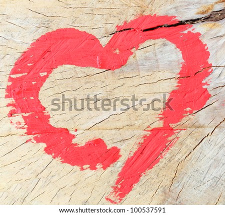 heart on a background of oak wood - stock photo