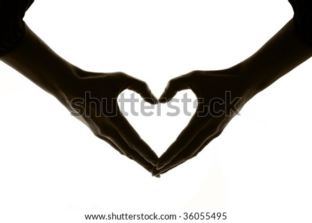Heart on a white background made by hands, black white - stock photo