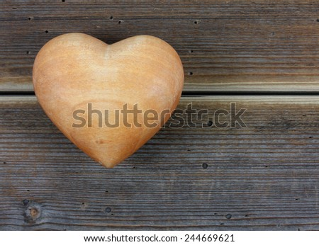 heart on a wooden background - stock photo