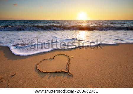 Heart on beach. Romantic composition. - stock photo
