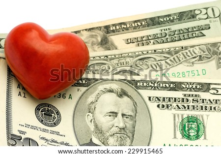 Heart on dollar concepts isolated on white - stock photo