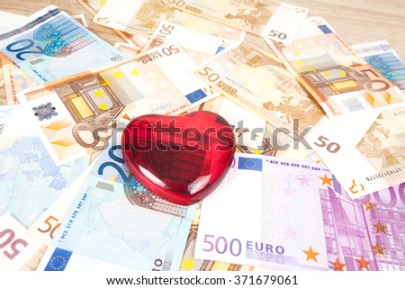 Heart on European currency. Many of Euro notes with heart - stock photo