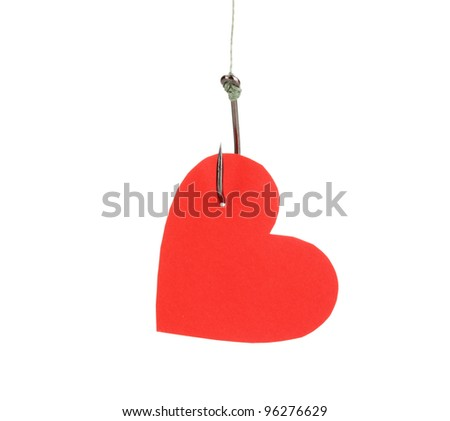 Heart on fish hook isolated on white - stock photo