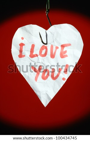 Heart on fishing hook. Love bait concept - stock photo
