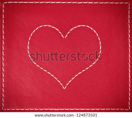 Heart on red leather background - stock photo