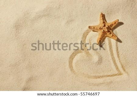 heart on sand on sea beach - stock photo