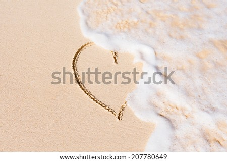 Heart on the beach. Love difficulties concept. - stock photo