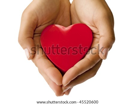Heart on the hand - stock photo