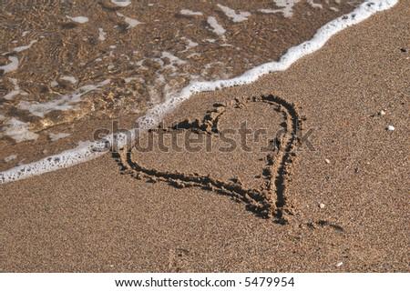 Heart on the sand - stock photo