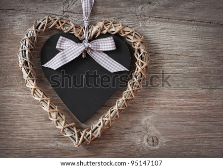 Heart on wooden background close up - stock photo