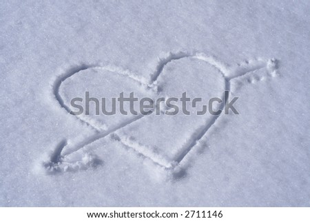 Heart pierced by cupid arrow (on snow)