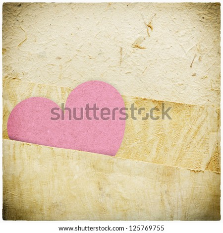 heart recycled paper stick on paper background Vignette photo and border - stock photo