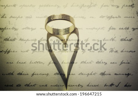Heart reflection in book - stock photo