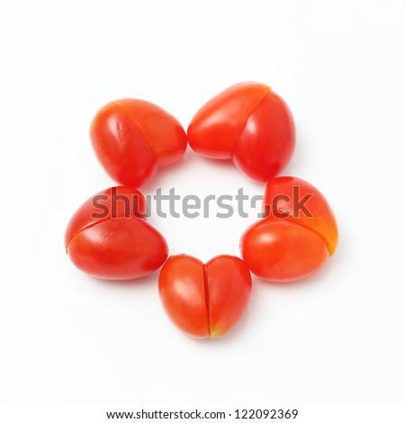 Heart ring shaped tomato on white background - stock photo
