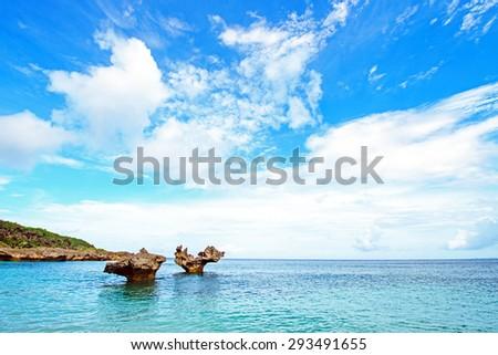 Heart rocks and the brilliant sky, Okinawa, Japan - stock photo