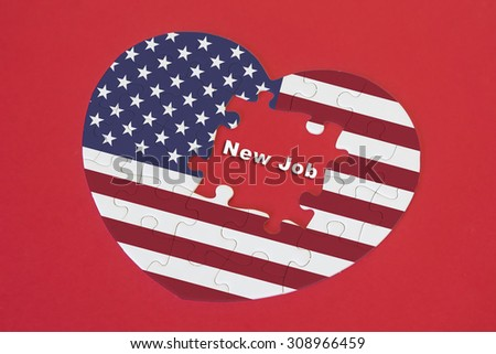Heart shape America Flag jigsaw puzzle with a written word New Job with red background - stock photo