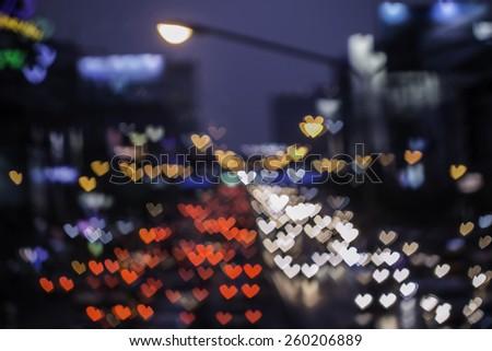 Heart shape bokeh from car light on the traffic road - stock photo