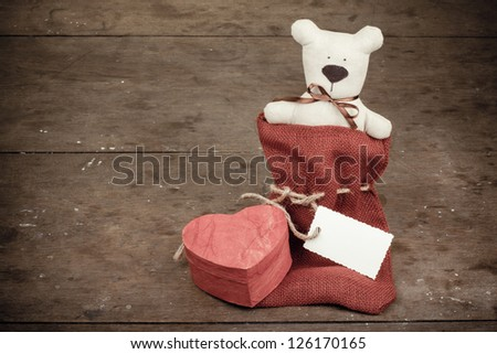 Heart shape box, handmade toy bear and gift tag vintage photo - stock photo