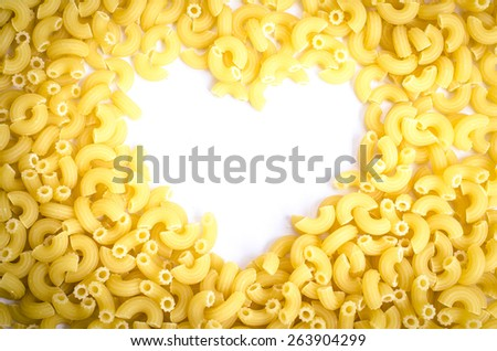 Heart shape by Italian Macaroni Pasta on white background. Love concept. - stock photo