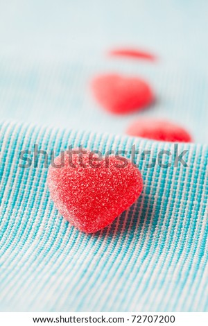 Heart shape candy for Valentine's day on a light blue background - stock photo