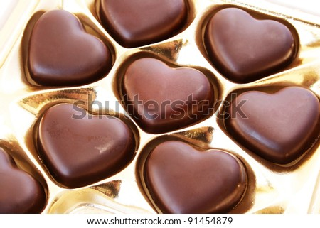 Heart shape chocolates in box. - stock photo