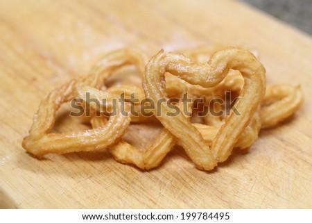 Heart shape churros - stock photo