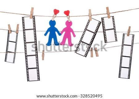 heart  shape clip on a  twine, hanging Negatives and COUPLE silhouette, love movie - stock photo