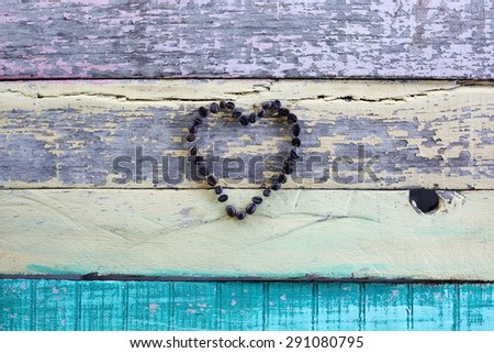 heart shape coffee beans on grunge background. - stock photo