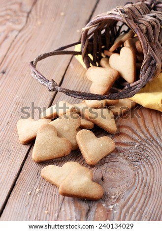 Heart shape cookies on a wooden table for Valentine's day in a vintage style. Copy space background - stock photo