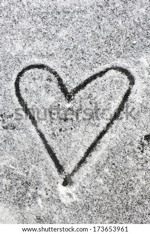 Heart shape drawn with the snow