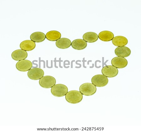 heart shape from coins  on white background with shadow, make money from heart, heart from golden coins - stock photo