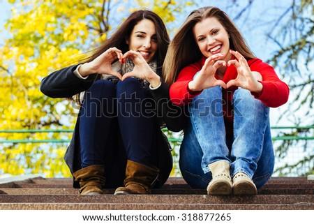 Heart shape from friends hands - stock photo
