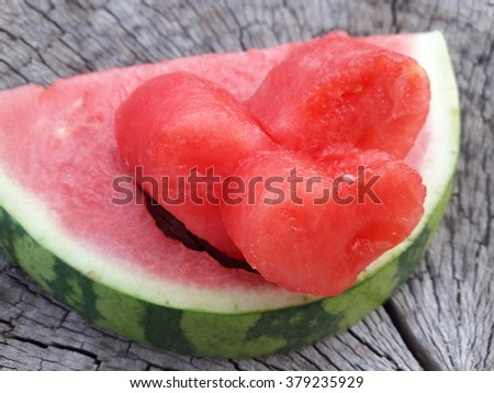 heart shape from water melon and wood background