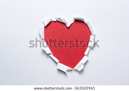 Heart shape handmade on white paper. Love and romance concept - stock photo