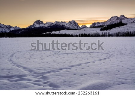 Heart shape in a frozen lake in the Idaho Mountains - stock photo