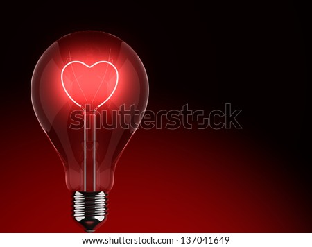 Heart shape in a light bulb on a black background - stock photo