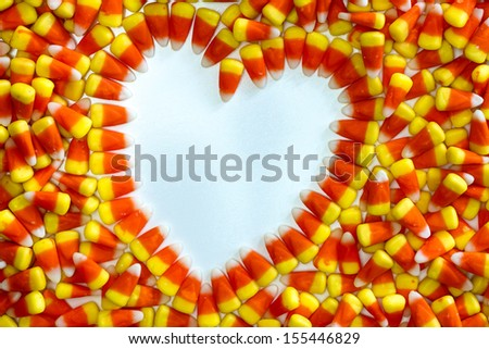 Heart shape in candy corn - stock photo