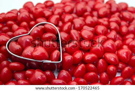 Heart shape in red hot cinnamon candies - stock photo