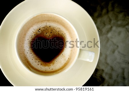 Heart shape inside hot coffee cup, Love concept
