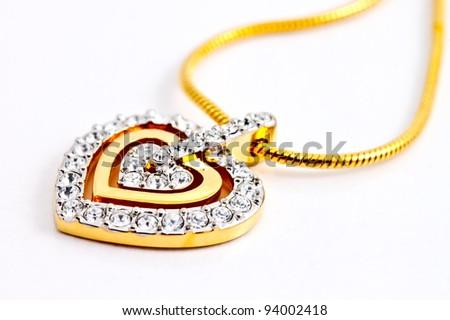 heart shape locket decorated with diamonds on white background - stock photo