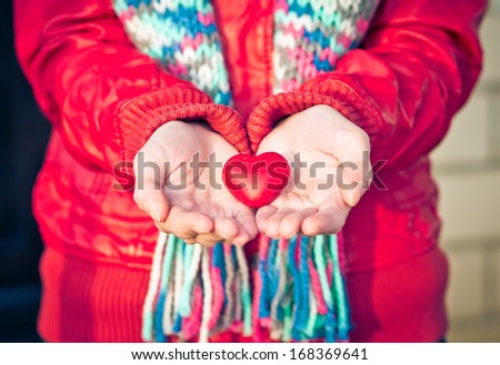 Heart shape love symbol in woman hands Valentines Day romantic greeting people relationship concept winter holiday - stock photo