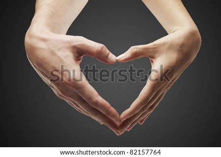 Heart shape  made of  female and male hands together.Isolated on a black background - stock photo