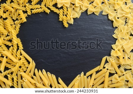 Heart shape made of fusilli, farfalle and penne pasta