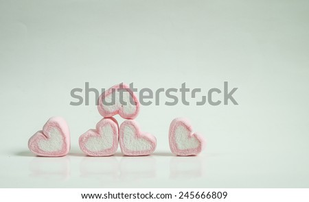Heart shape of marshmallows on white background, valentine day ,vintage tone color - stock photo