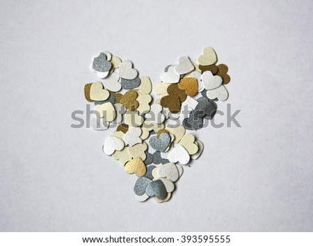 Heart shape of small love hearts on white background - stock photo