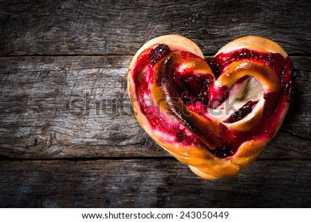 Heart shape pastry stuffed with cherry jelly - stock photo