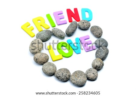 heart shape pebble stone with friend and love text