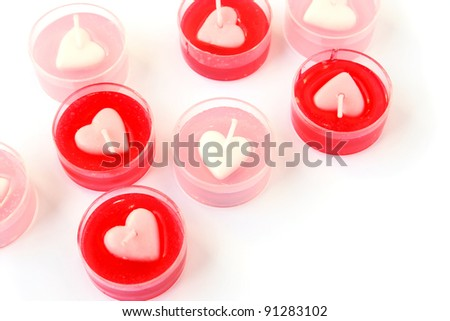 Heart shape red and pink candles  isolated on white background.