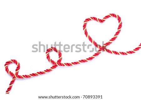 Heart shape rope isolated on white background - stock photo